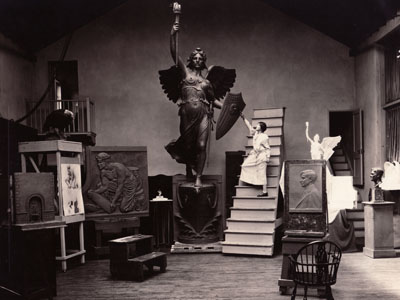 1.4.8 Beatrice Longman in studio with full scale model of Victory sculpture showing original design to base replication of altered objects.