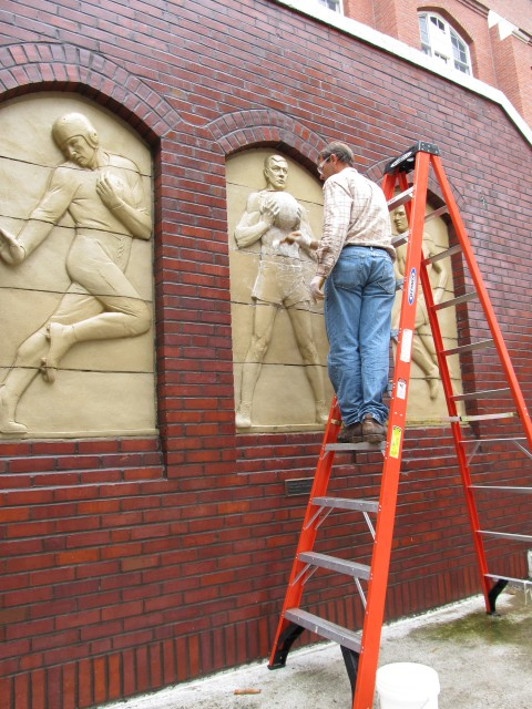 2.1.11 Three Athletes, Christian Petersen, 1936, University Museums, Iowa State University, Ames, IA.  Cleaning terra cotta during conservation treatment.