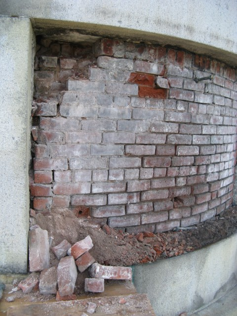 2.5.9 Failed mortar in brick core of historic monument.