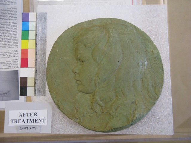 3.4.7 Girl Roundel, Petersen, Christian Petersen Art Museum, Iowa State University, Ames. Overview of plaster after conservation treatment.