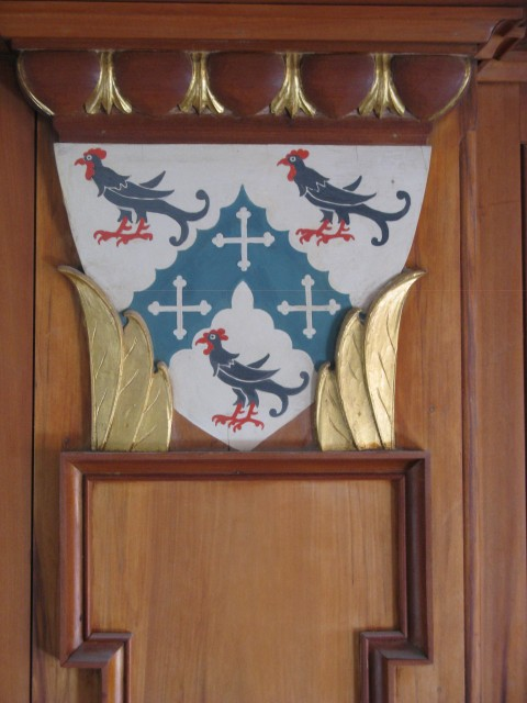 3.6.7 Crest, St. Thomas More Chapel, Yale University.  Painted and gilt wood after treatment.