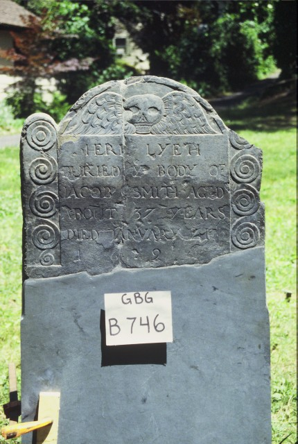 4.1.4 Jacob Smith, 1699, Granary Burying Ground, Boston, MA.  View of the repaired slate with a replacement slate base.