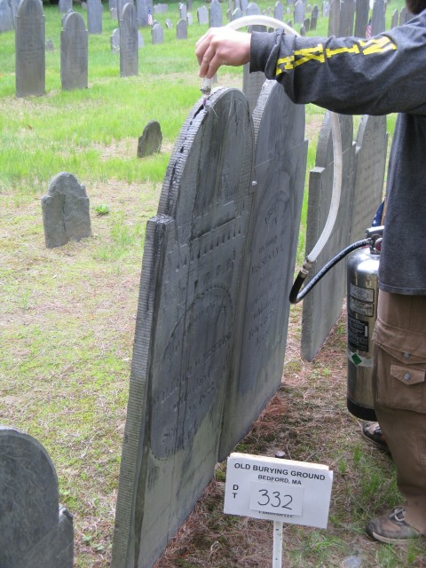 4.1.9 William Webber, ES, 1833, Old Burying Ground, Bedford, MA.  Cleaning top crack with compressed water.